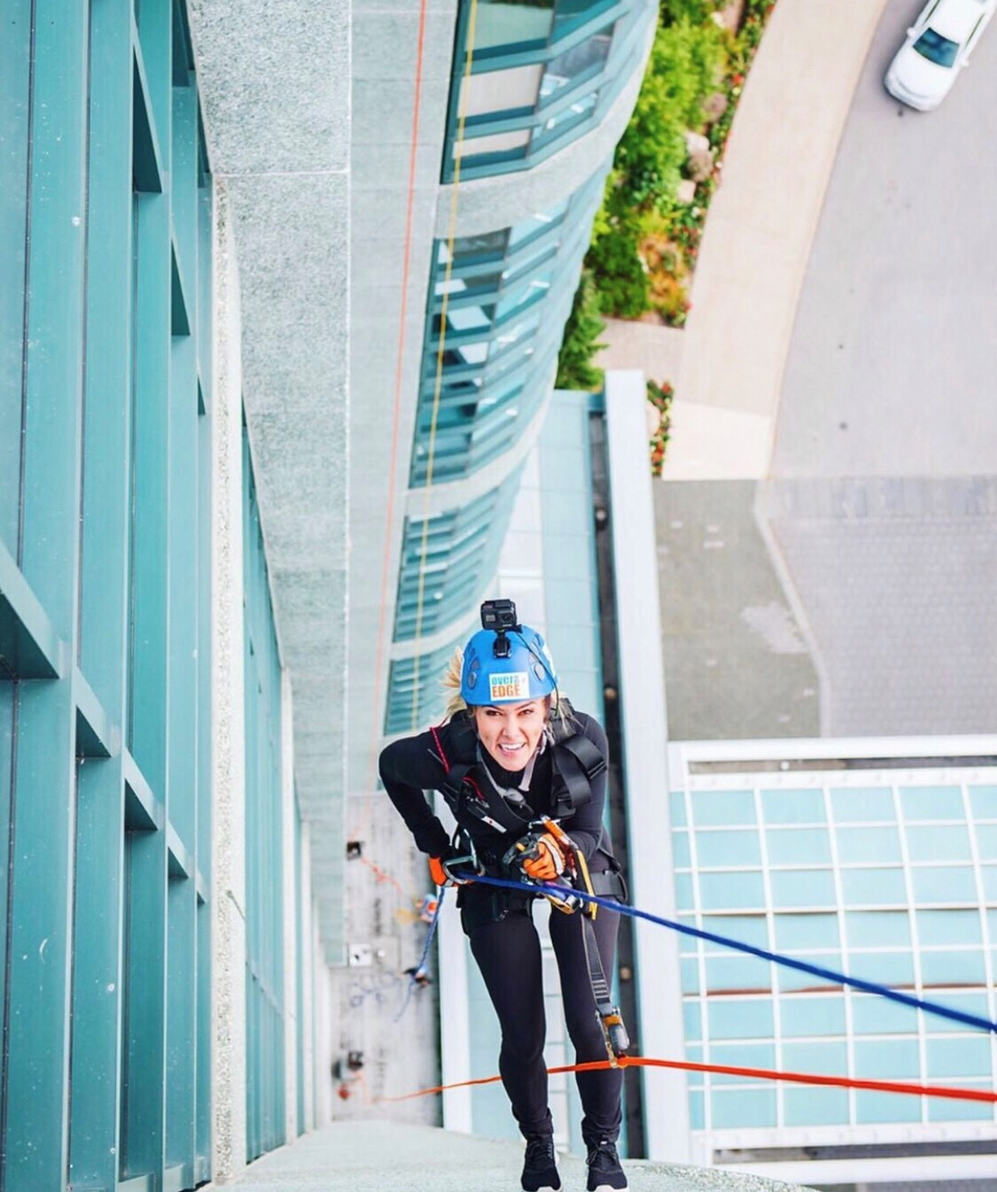Megan Shaw repelling off building